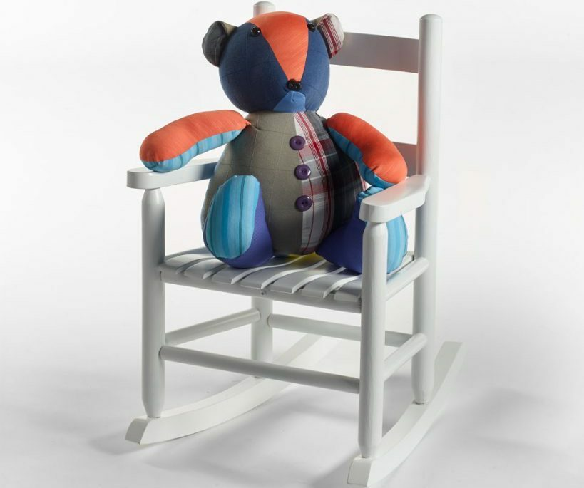 child's rocking chair with teddy bear